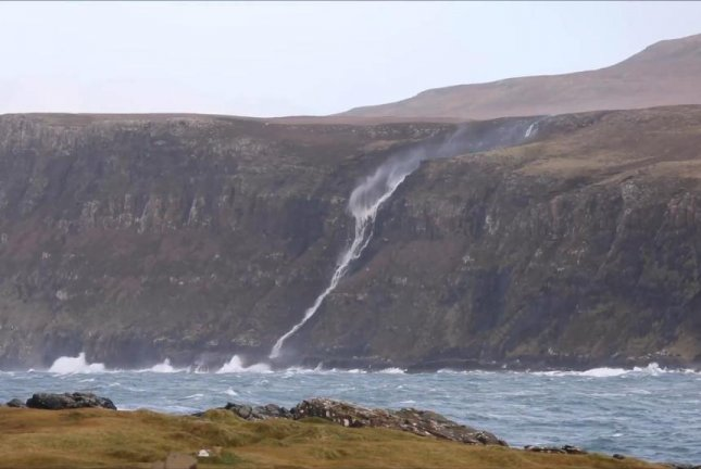 A waterfall in Scotland flows in reverse amid high winds. Screenshot: Newsflare