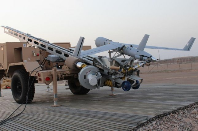 A ScanEagle UAV is pictured mounted on a catapult trailer. Photo by Lt. Charity Edgar/Operation Resolute Support Headquarters