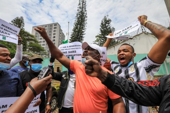 Nigerians living in Kenya hold placards and shout slogans during a protest against the Nigerian Special Anti-Robbery Squad in Nairobi Wednesday. United Nations Secretary-General Antonio Guterres condemned police for violence against demonstrators Tuesdays in Nigeria. Photo by Daniel Irungu/EPA-EFE