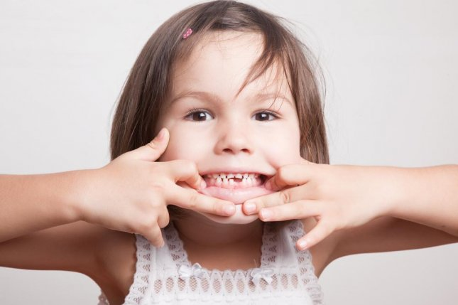 Cavities are the top dental issue effecting children, which led to a pediatricians group to suggest children start receiving fluoride treatments as early as possible. Photo by Radharani/Shutterstock