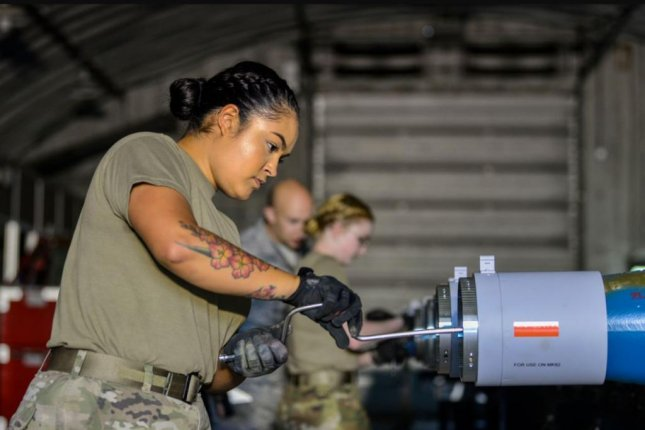 A1C Daelyn Mayer, a 354th Maintenance Squadron conventional maintenance inspector, helps build bombs specifically for the F-35A Lightning II at Eielson Air Base, Alaska. Photo by A1C Class Aaron Larue Guerrisky/U.S. Air Force