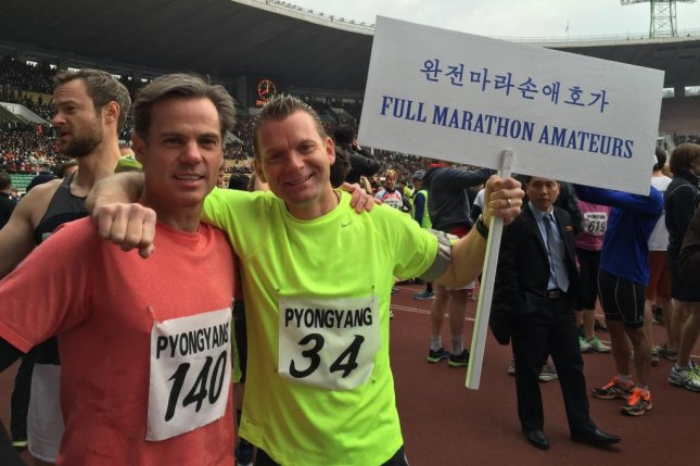 Stephen Forman, left, and friend Gary Thompson traveled to Pyongyang, North Korea, for the country's annual marathon on April 12. They ran with at least 600 other foreign runners in an event that was almost canceled due to North Korea's fear of the Ebola epidemic. Photo courtesy of Gary Thompson