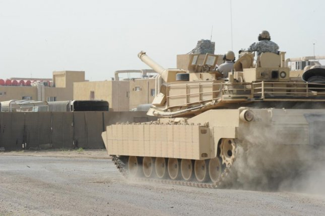 An M1A1 Abrams tank is driven on a tank course by Iraqi soldiers with the 9th Iraqi Army Division. Joint Combat Camera Center photo by Spc. Gary Silverman