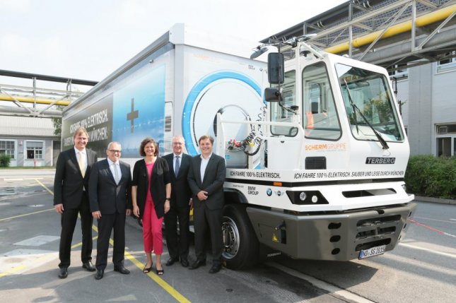 Top SCHERM and BMW staff pose alongside BMW's 40-ton, all-electric truck that began making rounds in Munich, Germany on July 7. Photo courtesy of BMW Group.