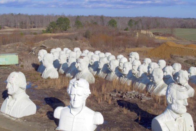 The 20-foot-tall busts of 43 U.S. presidents crumble on a Virginia farm. Screenshot: Storyful