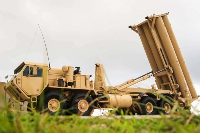 The Terminal High Altitude Area Defense weapon system, pictured at Andersen Air Force Base in Guam, consists of a launcher, interceptors, fire control and communications equipment, and the AN/TPY-2 tracking radar. Photo by Capt. Adan Cazarez/U.S. Army