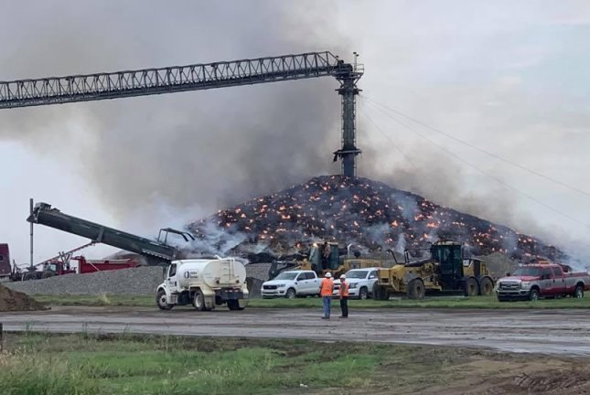 A soybean pile that began rotting after it was soaked in this spring's catastrophic Midwest flooding caught fire in July, and crews have been unable to put it out. Photo courtesy of W.C. Farmer Photography