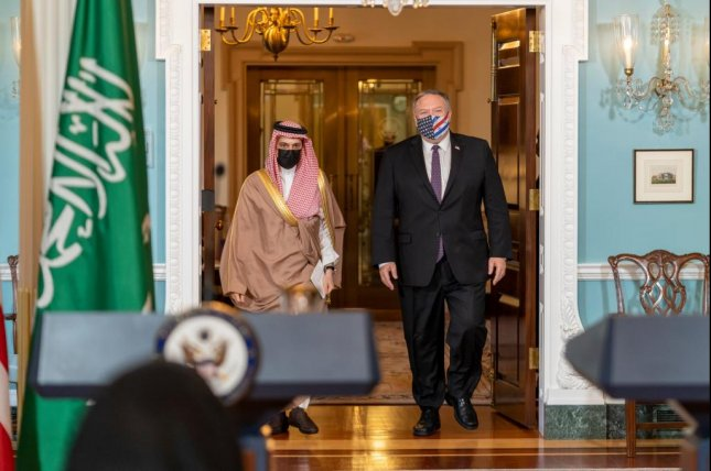 Secretary of State Mike Pompeo (R) walks with Saudi Foreign Minister Prince Faisal bin Farhan Al Saud during a meeting in Washington, D.C. Wednesday. Photo courtesy of Secretary of State Twitter.