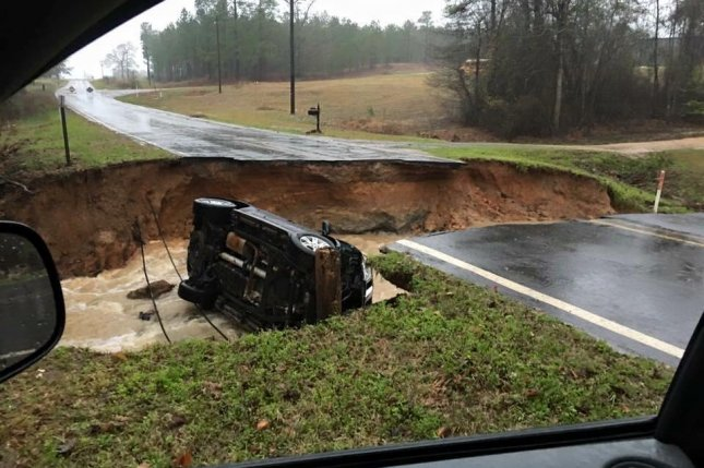 Damage due to flooding in the Webster Parish has led to multiple road closures. At least two people have died due to severe flooding created by a storm system affecting the southern United States that has forced evacuations. Photo courtesy of Louisiana Governor's Office of Homeland Security and Emergency Preparedness