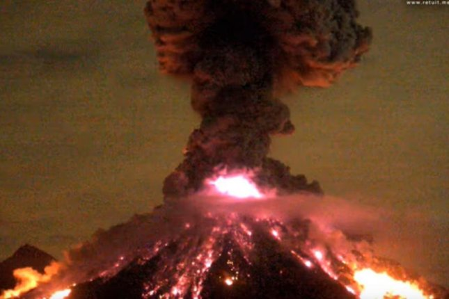 The night-time eruption of the volcano in Colima, on Mexico's Pacific coast, was recorded by a web cam located beyond the five-mile exclusion zone. Screenshot courtesy of YouTube