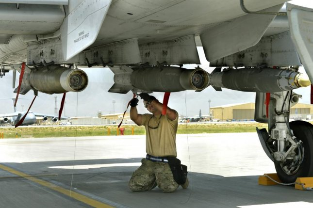 EDO Corporation will provide the Navy with 300 smart bomb racks. Pictured, U.S. Air Force personnel load munitions to an A-10C Thunderbolt II