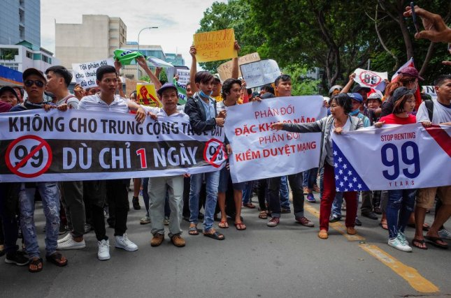 Vietnamese protesters in Ho Chi Minh, Vietnam, on June 10, protest a special leasing law that favor Chinese firms. The protests have been followed by the bombing of a police station in the city. File Photo by EPA-EFE