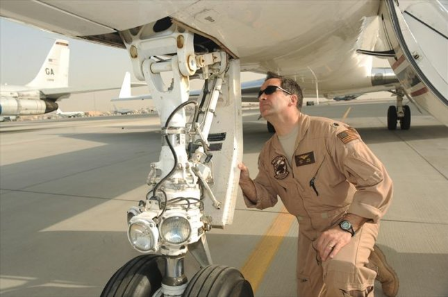 Gulfstream Aerospace Corp. has been awarded an $80.1 million deal to maintain C-20 and C-37 aircraft for the military. In this photo, Navy Cmdr. Rich Ross, 379th Expeditionary Operations Group C-20 pilot, conducts a pre-flight inspection on a C-20 aircraft before takeoff at an air base in Southwest Asia, in 2010. Photo by Michelle Larche/U.S. Air Force