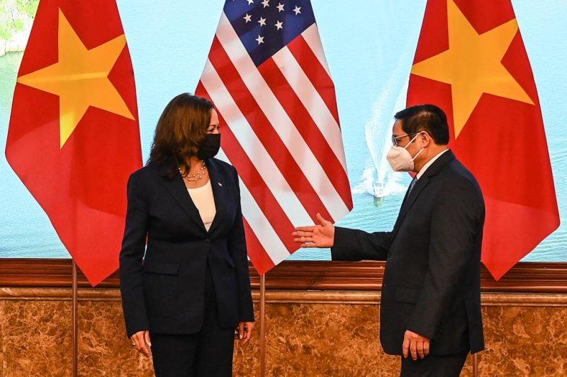Vietnam Prime Minister Pham Minh Chinh speaks with U.S. Vice President Kamala Harris on Wednesday at a government office in Hanoi, Vietnam. Photo by Manan Vatsyayana/EPA-EFE