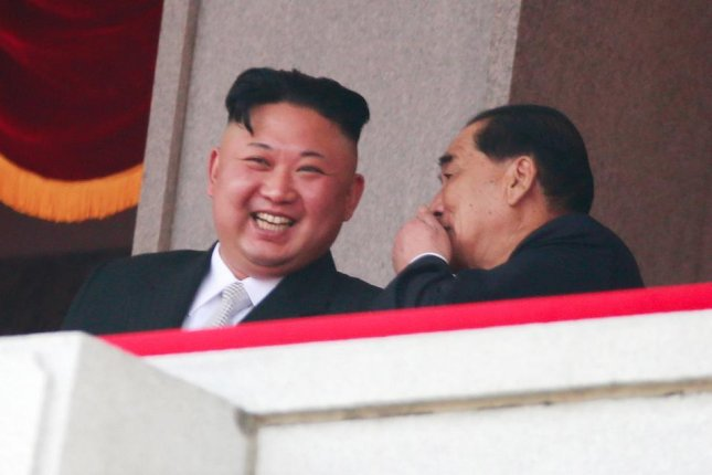 North Korean leader Kim Jong Un (L) speaks with North Korean Premier Park Pong Ju (R) during a parade for the Day of the Sun festival on Kim Il Sung Square in Pyongyang, North Korea, on April 15. Photo by How Hwee Young/EPA