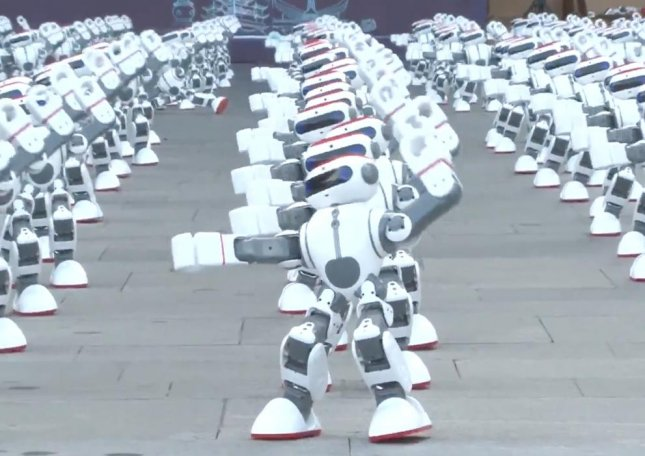 About 1,069 dancing robots completed a synchronized dancing routine to claim a Guinness World Record for Most robots dancing simultaneously. Screen capture/Guinness World Record/YouTube