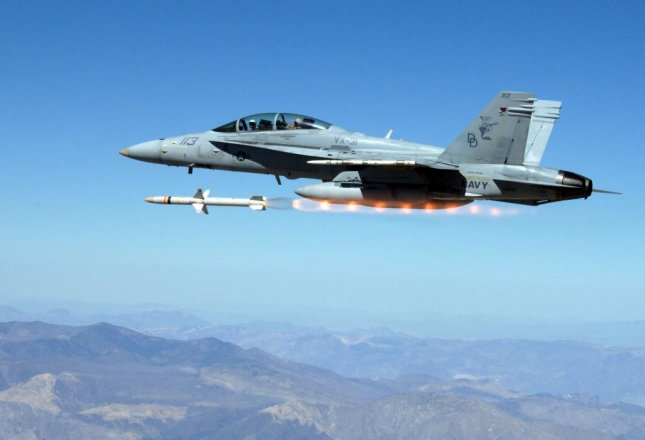 A U.S. Navy fighter fires an AGM-88E missile. U.S. Navy photo