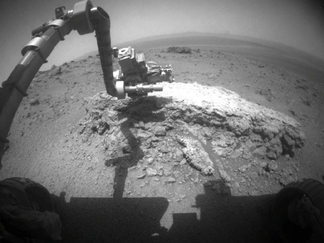 NASA's Mars Exploration Rover Opportunity used its front hazard-avoidance camera to take this picture showing the rover's arm extended toward a light-toned rock. Credit: NASA/JPL-Caltech