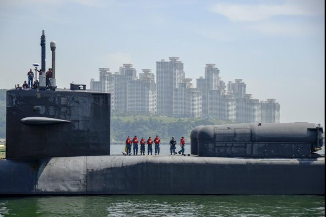 Oceaneering International and General Dynamics Electric Boat have been awarded fourth-year contract options for U.S. and foreign national submarine work. The USS Ohio boat is shown arriving in South Korea this summer. U.S. Navy photo