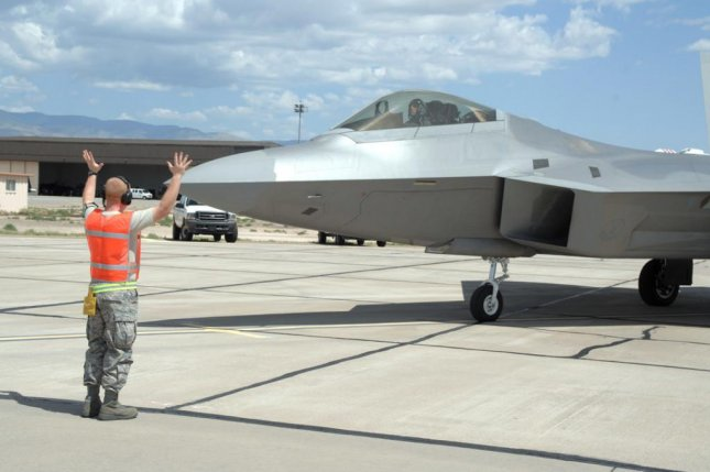 Tech. Sgt. Dennis Thomas, a maintainer with the 49th Aircraft Maintenance Squadron at Holloman Air Force Base, N.M., marshals an F-22 Raptor. Photo by Airman 1st Class Jamal D. Sutter/U.S. Air Force