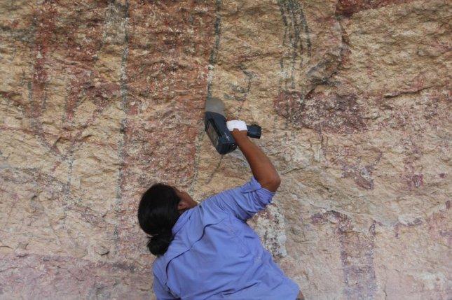 Researchers used an X-ray gun to analyze dozens of spots on a large mural painted on a limestone canyon wall in Texas. Photo by Shumla Archaeological Research and Education Center