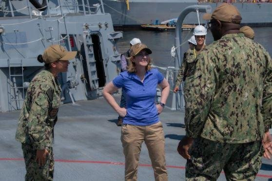 Deputy Defense Secretary Kathleen Hicks, C, visited Bath Iron Works Bath, Maine, this week, at a time the company fears a reduction in orders for Navy destroyers will lead to layoffs. Photo courtesy of Department of Defense