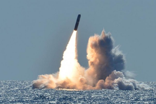 An unarmed missile is test-fired from an Ohio-class U.S. Navy submarine. Photo by MCS1 Ronald Gutridge/U.S. Navy