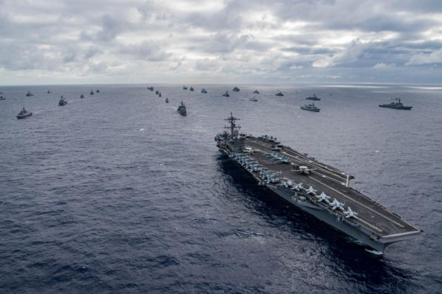 An international group of naval ships assembles for a photo exercise off the coast of Hawaii during the Rim of Pacific Exercise 2018. Photo by Dylan M. Kinee/U.S. Navy