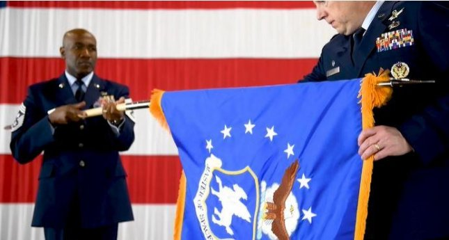 CMSgt. Boston Alexander furls the flag as Col. James Smith relinquishes command of the U.S. Air Force 50th Space Wing on Friday, part of the realignment ceremony of the U.S. Space Force. Screenshot courtesy of U.S. Space Force