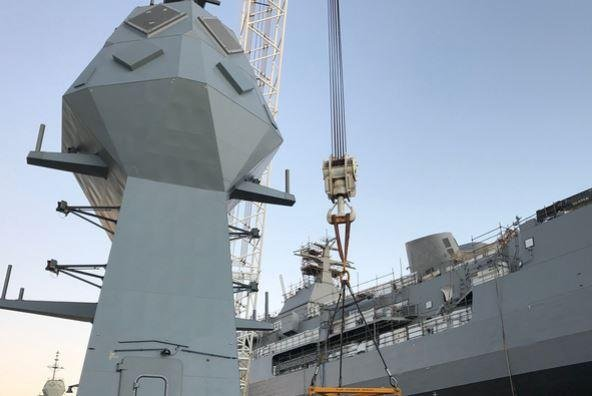 A new mast was installed Monday on the Royal Australian Navy frigate HMAS Anzac, part of an upgrade that began in September 2018. Photo courtesy of BAE Systems
