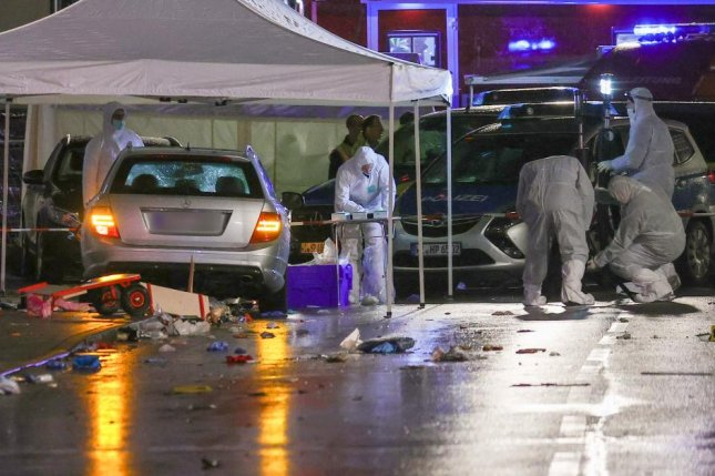 Forensic experts investigate the scene of a crash in Volkmarsen, Germany, on Monday, where a crowd of 52 people were injured by the vehicle. Photo by Armando Babani/EPA-EFE