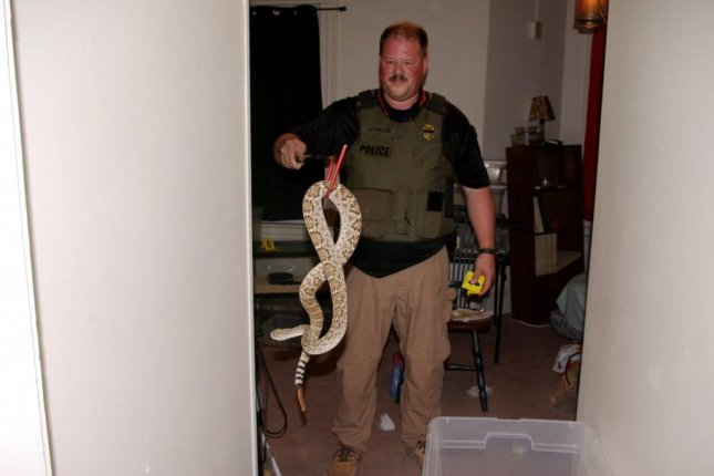 A former zoo employee in Maryland was charged with animal cruelty and illegally keeping venomous snakes after police seized the reptiles from his home. Photo courtesy of Maryland Natural Resources Police