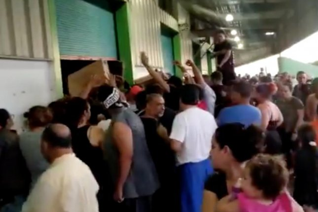 People crowd outside a warehouse in Ponce, Puerto Rico where a video had surfaced showing unused aid. The U.S. territory has been declared a major disaster since a series of earthquakes caused massive structural damage and a power outage.