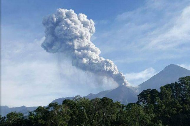 The Santiaguito volcano in Guatemala, seen here erupting on Wednesday, has recently had increased volcanic activity, which has generated ash plumes up to 20,000 feet high. Photo courtesy of the National Coordination of Disaster Reduction of Guatemala