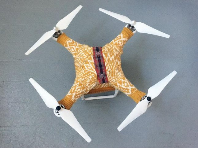 A San Francisco-based artist has created a custom-fitted drone sweaters which serve as a fun and functional way to keep the machines warm in cold weather environments. Danielle Baskin conceived the idea as a joke, but ultimately learned the insulation provided by the sweater can actually preserve a drone's battery performance in cold weather. Photo courtesy dronesweaters.com