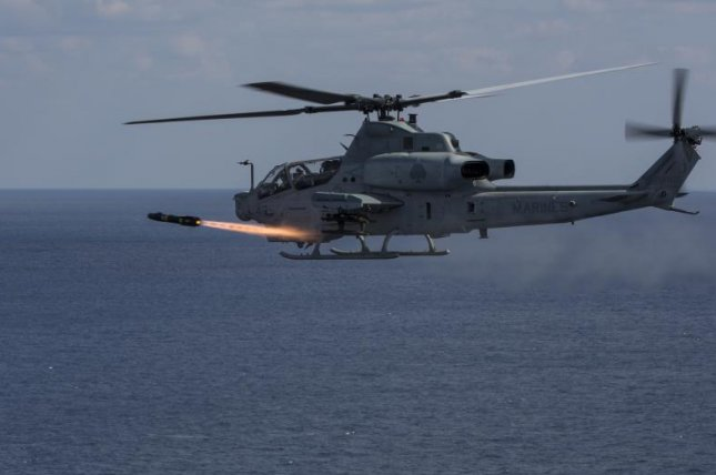 The Hellfire missile family can be fired from fixed- and rotary-wing aircraft. Pictured, an AH-1Z Viper deploys a Hellfire missile during an exercise in Okinawa, Japan. Photo by MCIPAC Combat Camera Lance Cpl. Sean M. Evans/U.S. Marine Corps
