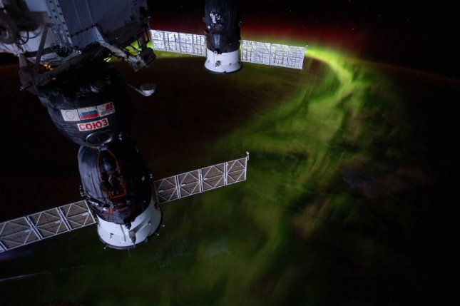 The International Space Station offers a view of Earth's aurorae, including the so-called southern lights, seen here swirling above the Indian Ocean. Photo by NASA