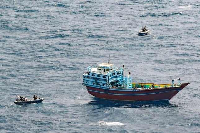 Personnel from the guided-missile destroyer USS Winston S. Churchill last week boarded a stateless dhow off the coast of Somalia, pictured, and interdicted an illicit shipment of weapons and weapon components. Photo by Louis Thompson Staats IV/U.S. Navy