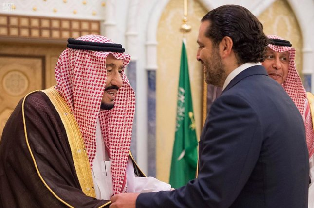 Saudi King Salman bin Abdulaziz Al Saud (L) meets with former Lebanese Prime Minister Saad Hariri Monday in Riyadh, Saudi Arabia. Riyadh has told its citizens to leave Lebanon immediately. Photo by EPA-EFE/Saudi Press Agency