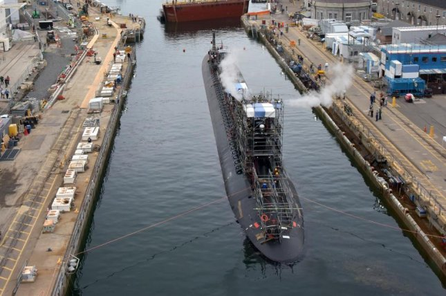 The USS Virginia submarine is pictured undocking in June at Portsmouth Naval Shipyard, where it had been for a scheduled maintenance period. Photo courtesy of Jim Cleveland/U.S. Navy.