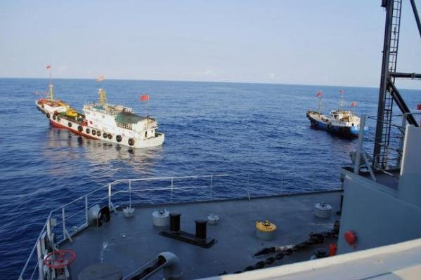Two Chinese trawlers stop directly in front of a U.S. ship in 2009. South Korea has joined the United States and Japan in stressing the importance of freedom of navigation in the South China Sea. File Photo courtesy of U.S. Navy