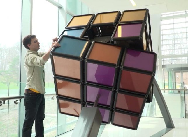 Engineering students at the University of Michigan unveiled a 1,500 pound Rubik's Cube, believed to be the largest hand-solvable, stationary version of the puzzle.  Screen capture/Michigan Engineering/YouTube