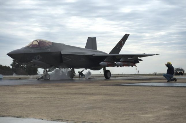 Lt. Cmdr. Christopher Tabert, F-35 Pax River Integrated Test Force test pilot, takes CF-5, a Navy F-35 variant, on one of the last system development and design tests with a 2,000 pound external weapons catapult March 19 at Naval Air Station Patuxent River, Md. Photo by Arnel Parker/U.S. Navy