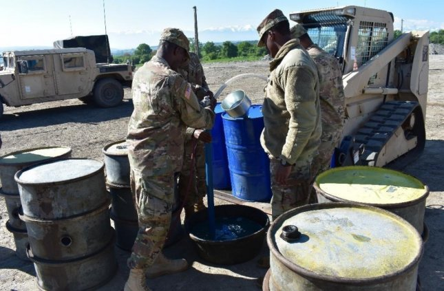 Soldiers of the Forward Support Company, 122nd Eng. Bn. pump used oil into proper containers for storage and removal at Joint National Training Center, Cincu, Romania, as participants of Resolute Castle 17. Resolute Castle 17 is an exercise strengthening the NATO alliance and enhancing its capacity for joint training and response to threats within the region. Photo by 1st Lt. Curtis Wright, 926th Engineer Brigade/U.S. Army