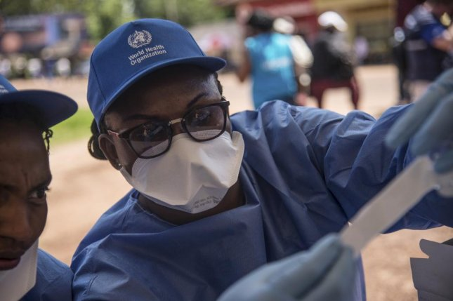 A World Health Organization worker prepares to administer an Ebola vaccination in Mbandaka, Democratic Republic of the Congo, on May 21. Photo by EPA-EFE