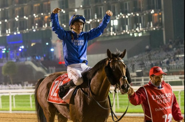 Jockey Christophe Soumillon celebrates Thunder Snow's second straight win in the $12 million Dubai World Cup. Photo by Erika Rasmussen/Dubai Racing Club