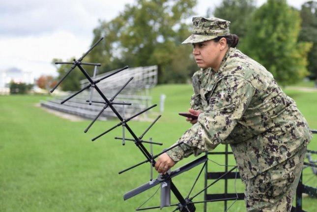 Construction Electrician 2nd Class Corinna Wentz,installs a satellite communications antenna for a demonstration of the Mobile User Objective System at Fort George Mead, Md., on Oct. 26, 2019. Photo by MCS1 Samuel Souvannason/U.S. Navy