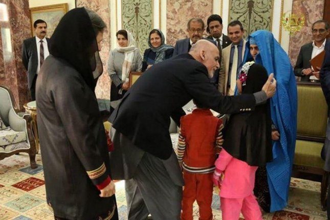 Sharbat Gula, seen in this image dressed in blue, the subject of the Afghan Girl National Geographic cover, was deported from Pakistan to Afghanistan on Wednesday and met with Afghan President Ashraf Ghani. Photo courtesy of Ashraf Ghani