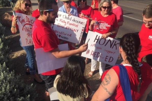 Since Gov. Ducey signed into law an education budget which will raise teacher pay 20 percent by 2020, Arizona teachers are expected to return to the classroom after striking to demand better pay since last Thursday. Photo courtesy Arizona Educators United/Twitter