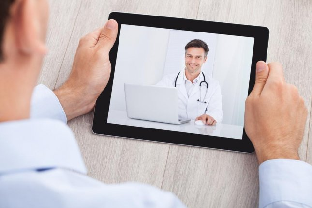 Many medical services can be delivered using video-conferencing technology and electronic medical records, however doctors need to be aware of their limitation, said a physicians group. Photo by Andrey_Popov/Shutterstock